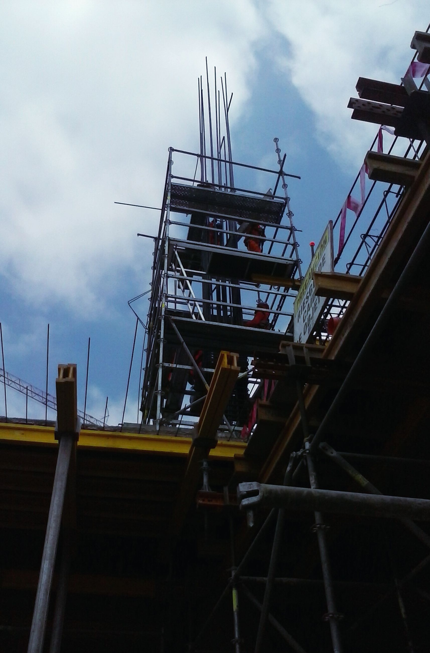 low angle view, built structure, architecture, construction site, sky, crane - construction machinery, construction, industry, cloud - sky, building exterior, development, crane, incomplete, construction industry, cloudy, cloud, metal, outdoors, no people, day