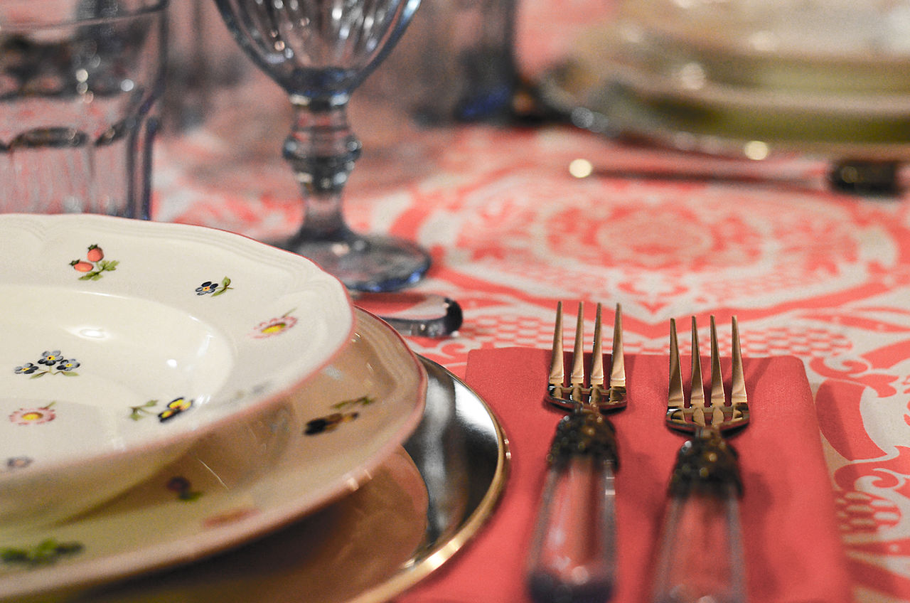 place setting close-up Close-up Dinner Placements Focus On Foreground Forks Indoors  No People Place Settings Plate Red Red Table Cloth Selective Focus Selective Focusing Soft Tones Still Life Table Table Cloth Table Set Table Setting Table Settings