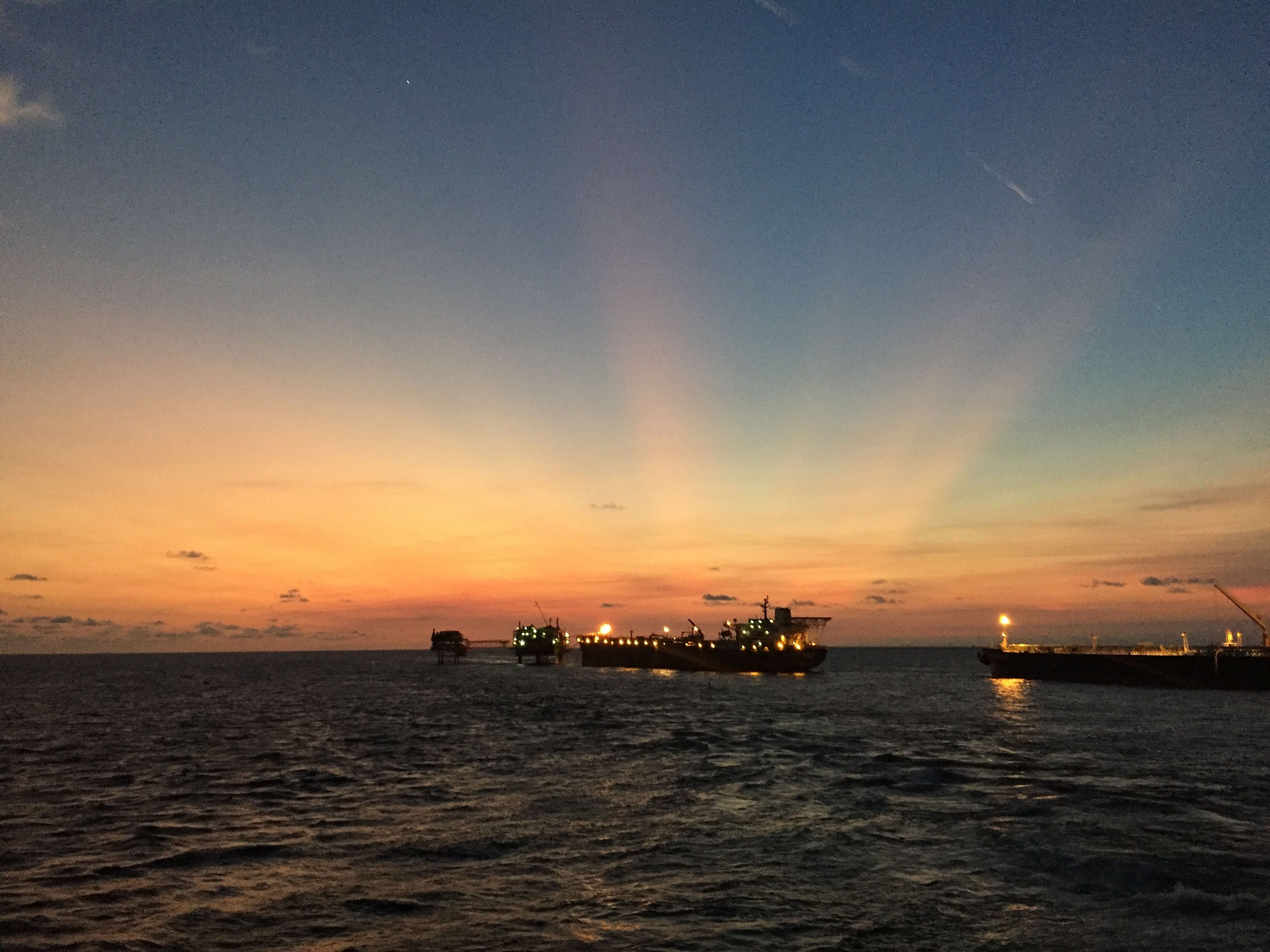 sea, sunset, water, beauty in nature, tranquility, business finance and industry, nautical vessel, scenics, nature, outdoors, horizon over water, sky, no people, offshore platform, day