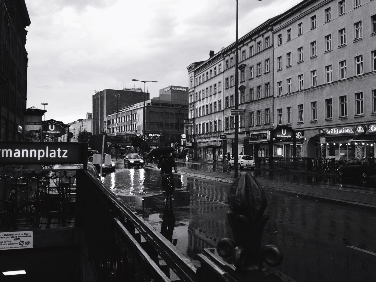 Welcome To Black Berlin Berliner Ansichten Rainy Days Hermannplatz Streetphoto_bw Streetphotography Urban Lifestyle Transportation City Reflection Real People Outdoors City Life The Street Photographer The Street Photographer - 2017 EyeEm Awards