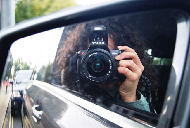 Photography Themes Camera - Photographic Equipment Photographing Digital Camera Holding One Person Technology Close-up Day Photographer Human Hand One Woman Only Car