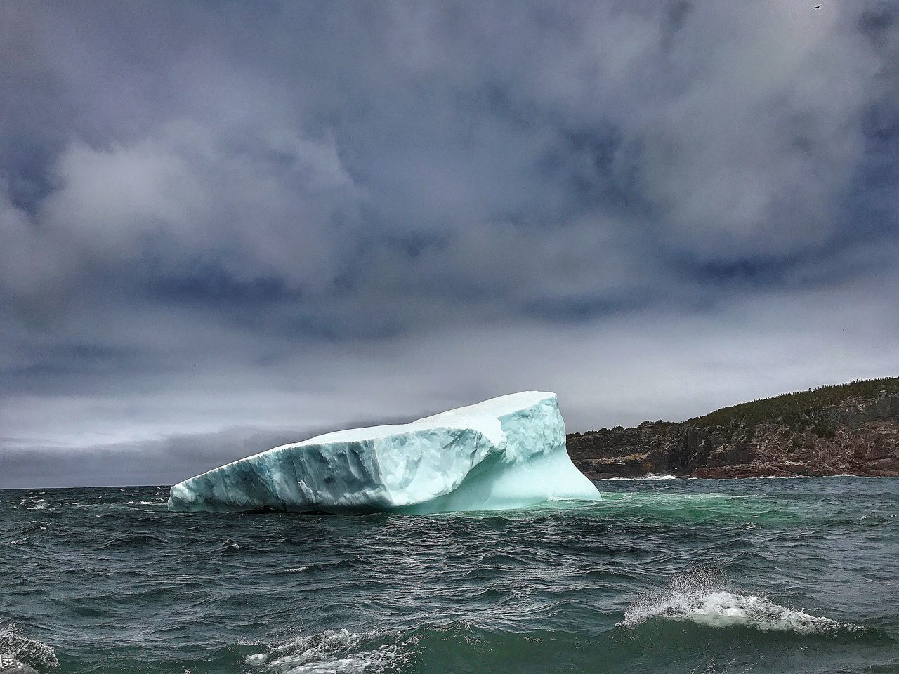 Iceberg - Newfoundland Canada - iPhone 7 Plus Beauty In Nature Sea Nature Cloud - Sky Glacier Cold Temperature Sky Ice Scenics Water Iceberg - Ice Formation No People Outdoors Frozen Iceberg Winter Day Storm Cloud Horizon Over Water The Great Outdoors - 2017 EyeEm Awards IPhoneography Canada