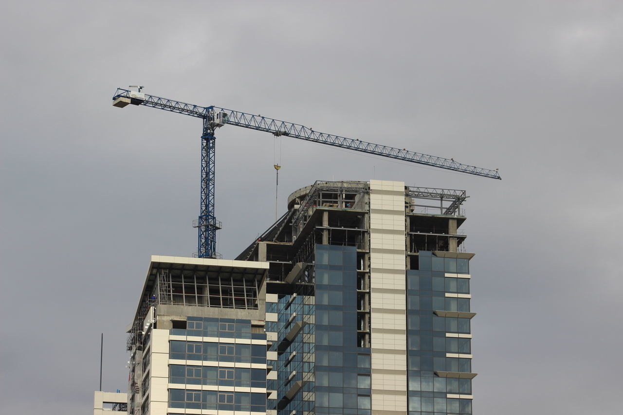 Building Exterior Business Finance And Industry City Cloud - Sky Construction Site Crane Crane - Construction Machinery Day Development Factory Gray Sky Industry Low Angle View New No People Outdoors Sky