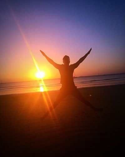 Jumping for joy.... Jumping Starjump Eyem Best Shots Eye4photography  EyeEm Nature Lover Sunset Sunshine Sunset Silhouettes Sunset_collection Silhouette Sun Sky Red Sea And Sky At The Beach Ocean View Ocean Happy Traveling Tranquility Tropical Paradise Shadow Night Fall Thailand Koh Lanta