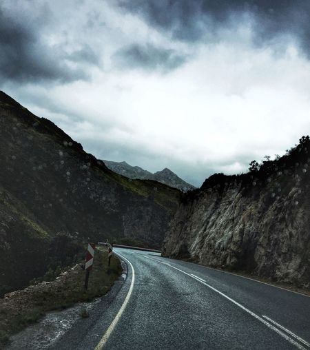 Journey Road The Way Forward Road Marking Transportation Mountain Sky Landscape Day Nature White Line Scenics Tranquility Outdoors Tranquil Scene Beauty In Nature Winding Road No People Mountain Road In The Rain Surprise Corners