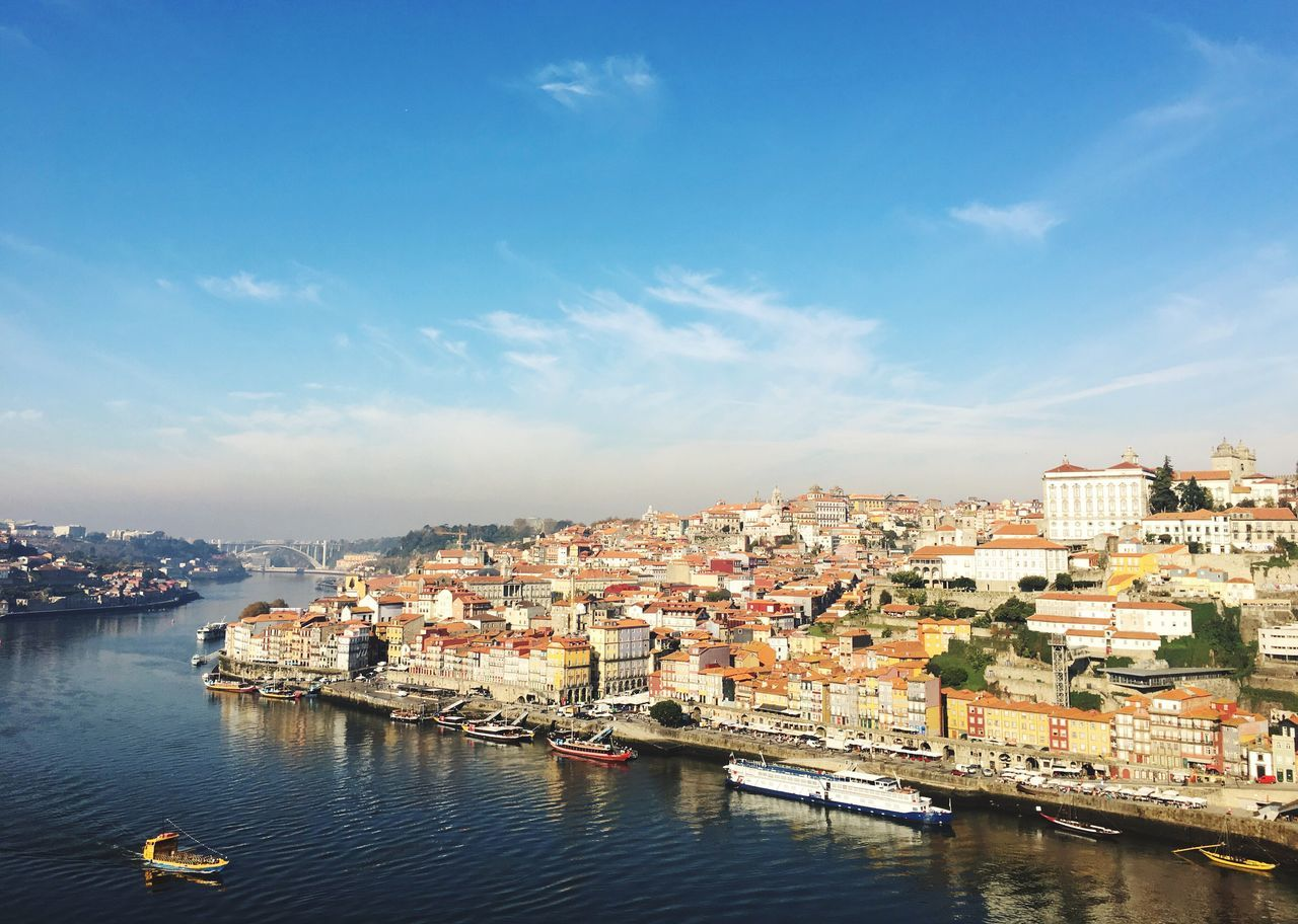 Architecture Building Exterior Built Structure Sky Water Residential Building Cityscape City Outdoors Crowded Day Community Porto Portugal Douro  River Landscape Cityscapes Heritage City Boats Harbor Colorful Visiting Travel Destinations