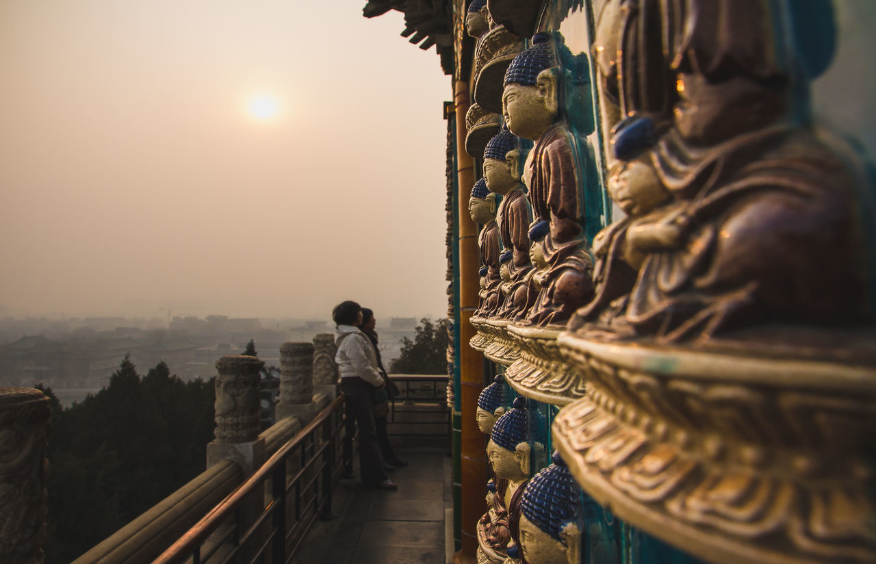 Tourists enjoying the view and the atmosphere at a Buddah Temple in Beijing ASIA Asian Culture Beijing, China Budda Statue Buddah Temple Temple - Building Temple Architecture Tourism Destination Tourist Attraction  Warm Colors Zen
