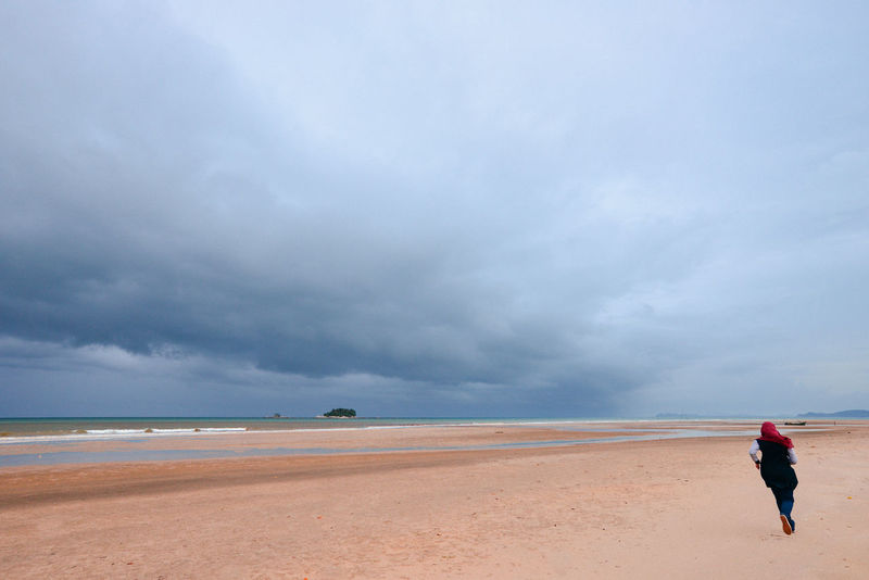 Beach Life Beach Beauty In Nature Cloud - Sky Day Full Length Horizon Over Water Nature One Person Outdoors Sand Scenics Sea Shore Sky Tropical Storm Water Lost In The Landscape Open Space Lost