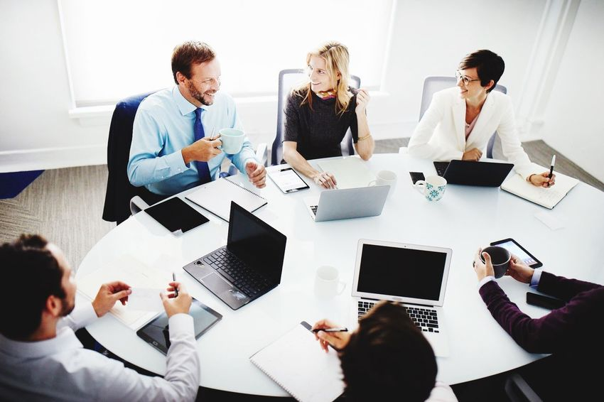 Workplace meeting. Business Businesswoman Businessman Wireless Technology Laptop Teamwork Business Finance And Industry Office Colleague Coworker Technology Business Person Meeting Discussion Using Laptop Corporate Business Business Meeting Digital Tablet Cooperation Communication