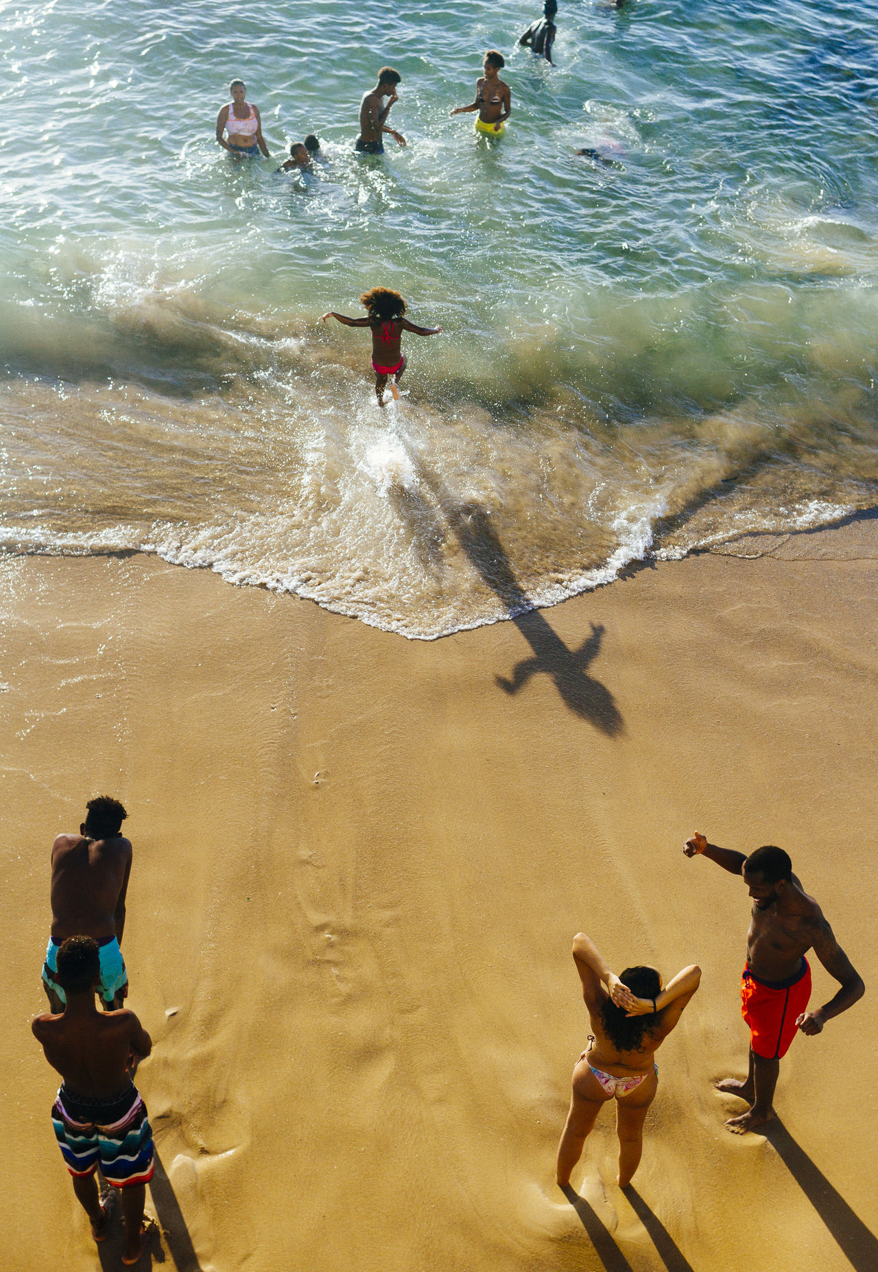 A girl runs towards the water to cool off Beach Day Happiness High Angle View Kid Running Kids Being Kids Leisure Activity Lifestyles Live For The Story Outdoors People Real People Sand Sea Standing Swimming The Street Photographer - 2017 EyeEm Awards Water