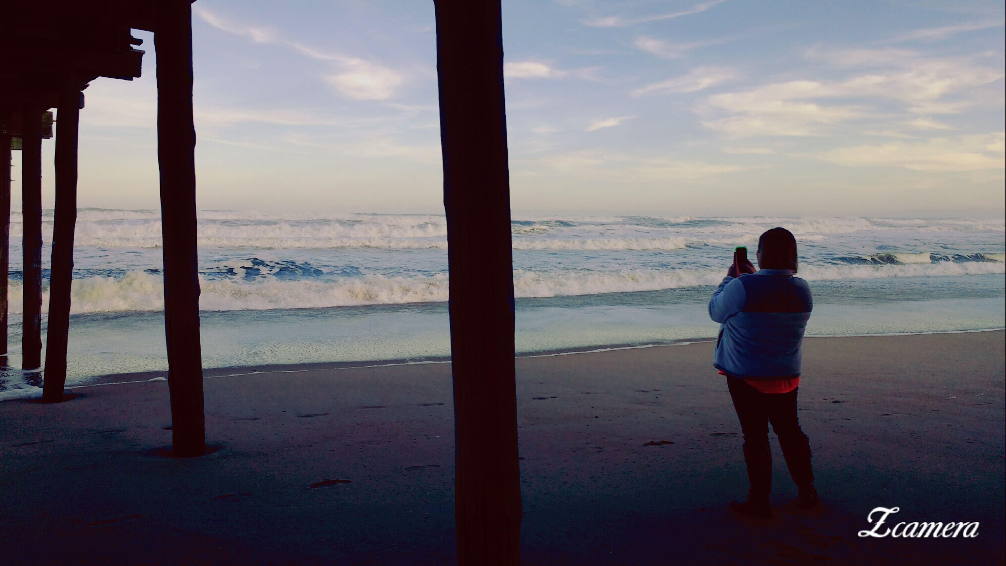 sea, standing, water, real people, full length, beach, beauty in nature, horizon over water, nature, lifestyles, leisure activity, sky, one person, scenics, sunset, outdoors, tranquility, cloud - sky, women, day, men, photographer, people