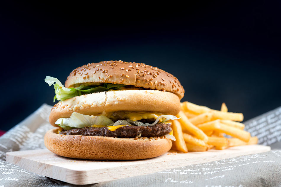 Black Background Bread Bun Burger Close-up Day Fast Food Food Food And Drink French Fries Freshness Hamburger Indoors  Lettuce Meal Meat Minced No People Prepared Potato Ready-to-eat Sesame Studio Shot Unhealthy Eating Vegetable