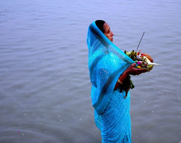 Indian Festival Of Light And Joy Diwali Women Who Inspire You Worshiping God Blue Chhathpuja Close-up Outdoors Real People Worshiping Sun