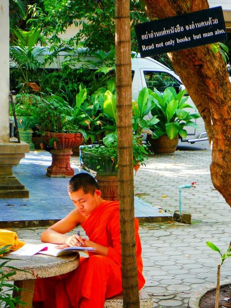 Perfect timing 😆 Buddhist Monk Conceptual Funny Ironic  Religious  Monk  Young Monk Chiang Mai Chiang Mai Thailand Chiang Mai | Thailand Thailand Temple Spirituality Asian Culture Asian Life Asian Temple Advice Advicequotes Wisdom Wisdomquotes Buddhist Wisdom Reading Read Wat Phra Sing Phra Singh Temple WatPhraSingh