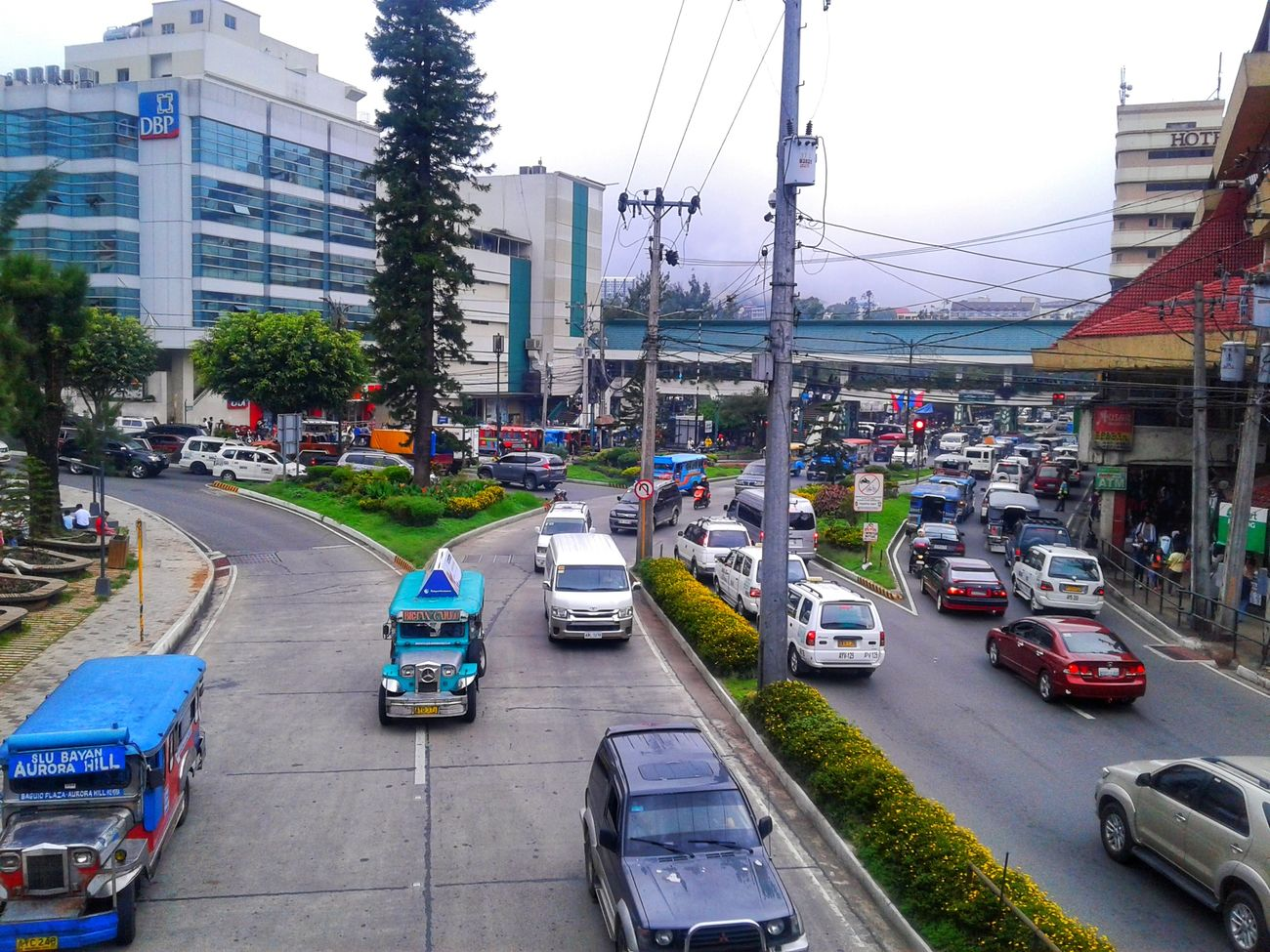 Car Transportation Traffic City Street Street City Mode Of Transport Land Vehicle Building Exterior Outdoors Architecture Road City Life Day Motorcycle Built Structure Cityscape No People Sky Busy streets of Baguio. The Photojournalist - 2017 EyeEm Awards The Street Photographer - 2017 EyeEm Awards