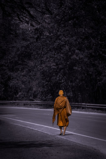 Alone Buddhism Detached EyeEm Best Edits EyeEm Best Shots Getting Away From It All Lifestyles Men Monastic Monk  On My Way One Color Priest Real People Release Side View Street Photography Streetphotography While he has walked on asphalt road without a shoes.