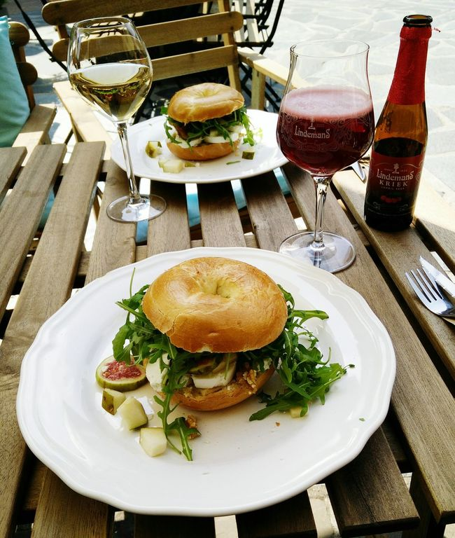 Lunch in the Sunshine Outdoors Bagel with Soft Goat Cheese, Fresh Figs, Pears and Rucola. Belgian  Lambic  Cherry Beer at Mea-Cuppa Cafein Maasmechelenvillage
