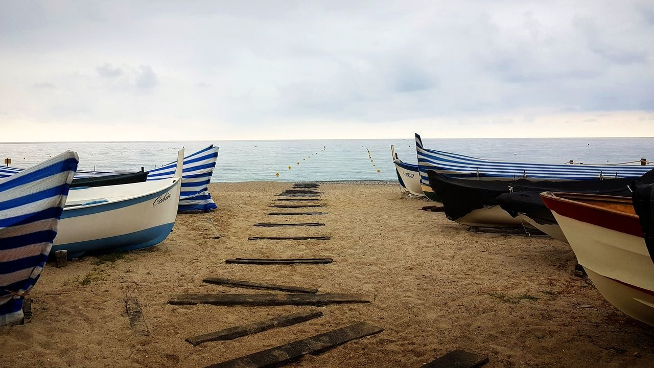 Beach Sand Sea Water Outdoors Sky Nature No People Boats And Clouds Boat And Sea Beach Travel Destinations Wave Barça Spiaggia Mare Barche First Eyeem Photo