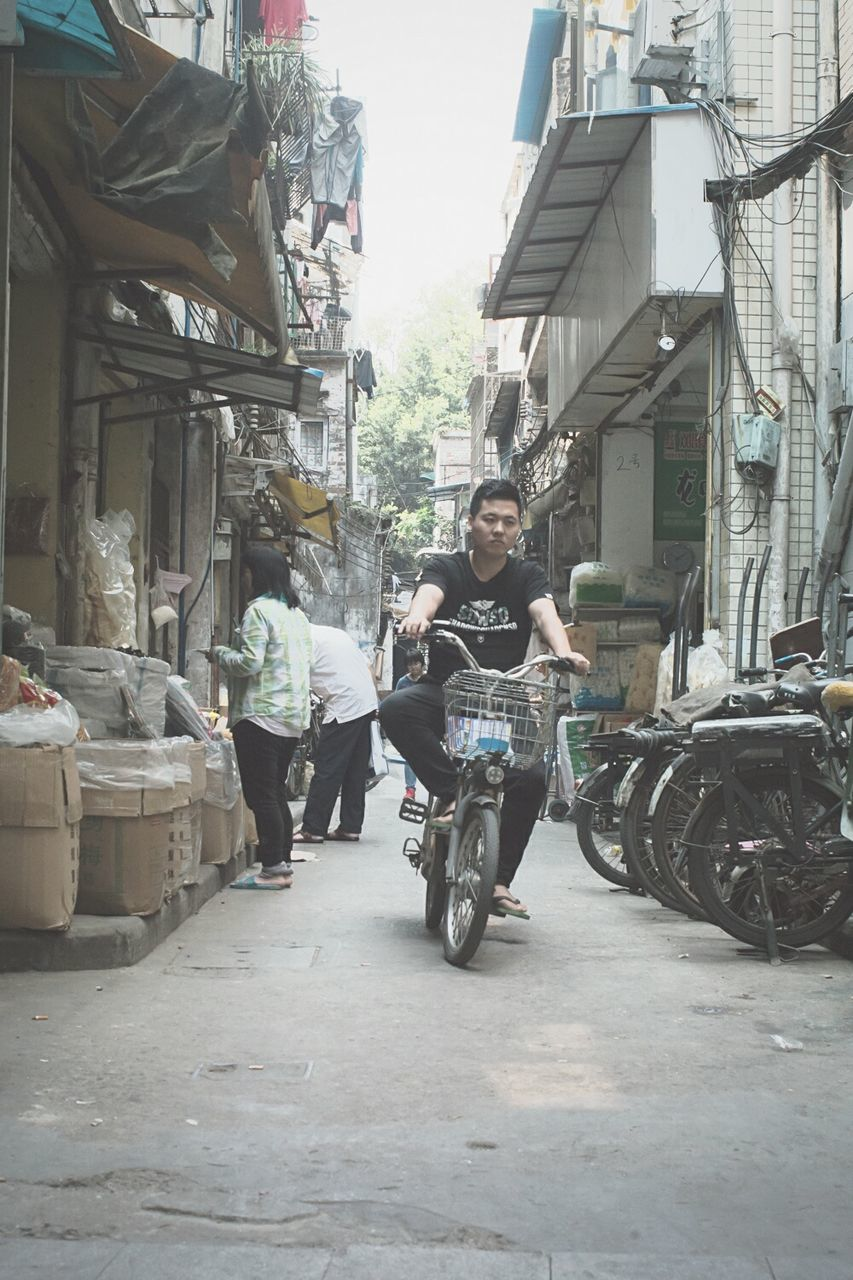 real people, transportation, motorcycle, architecture, two people, full length, built structure, building exterior, land vehicle, day, men, outdoors, young adult, city, people