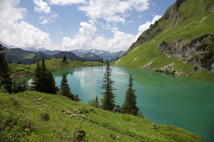 Beauty In Nature Cloud Cloud - Sky Countryside Day Grass Green Green Color Growth Idyllic Lake Landscape Mountain Mountain Range Nature No People Non Urban Scene Non-urban Scene Outdoors Remote Scenics Sky Tranquil Scene Tranquility Water