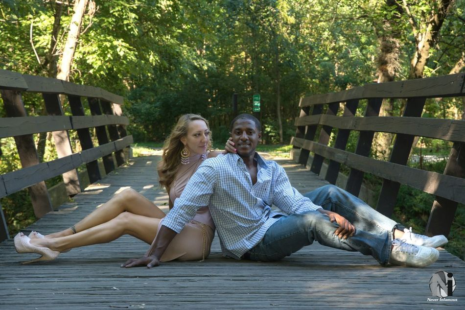 The look. Sitting Togetherness Lifestyles Love Full Length Person Railing Park - Man Made Space Young Adult Outdoors Engaged Engagement Couple People Photography Photoshoot Fashion Pennsylvania People In Places Affectionate Portrait Portraits Session Bridge Bridge - Man Made Structure