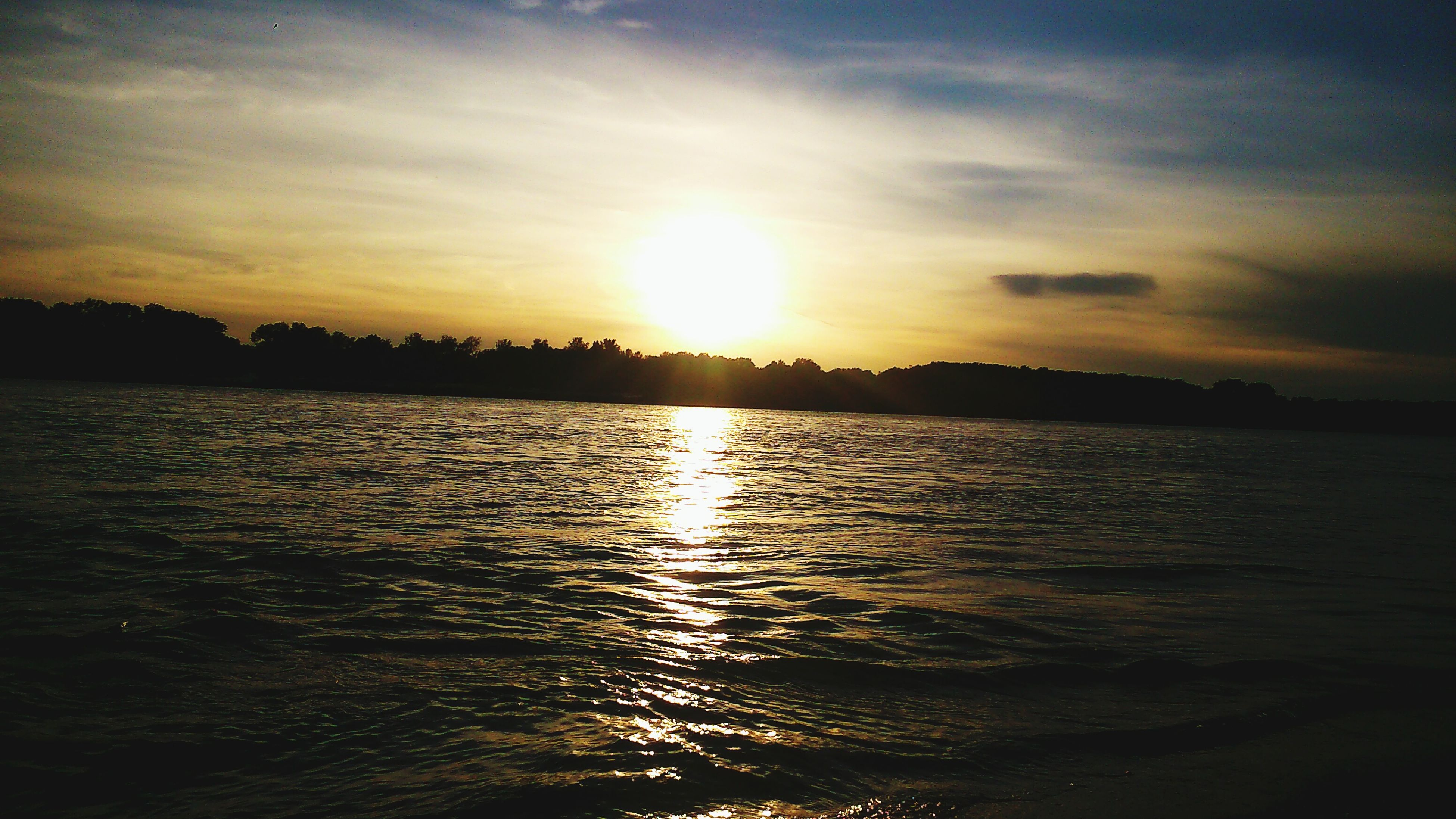 water, sunset, sun, reflection, tranquil scene, waterfront, scenics, tranquility, beauty in nature, sky, rippled, silhouette, sunlight, nature, idyllic, sea, cloud - sky, lake, sunbeam, outdoors