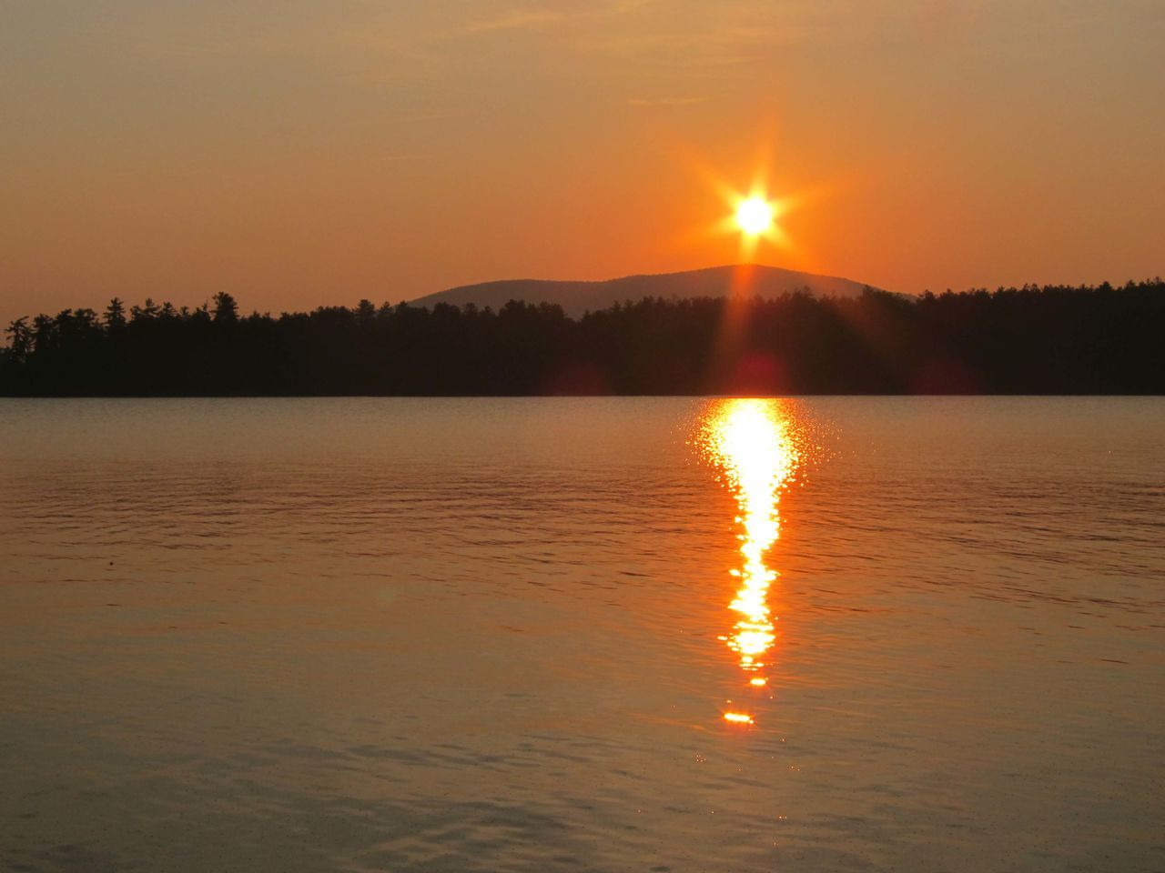 sunset, sun, reflection, nature, beauty in nature, orange color, scenics, tranquility, tranquil scene, no people, water, sunlight, silhouette, sky, outdoors, lake, tree