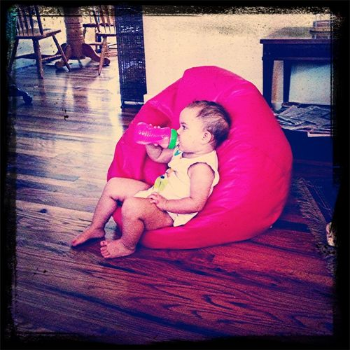 Chilling on her beanbag, watching Mickey Mouse clubhouse :)
