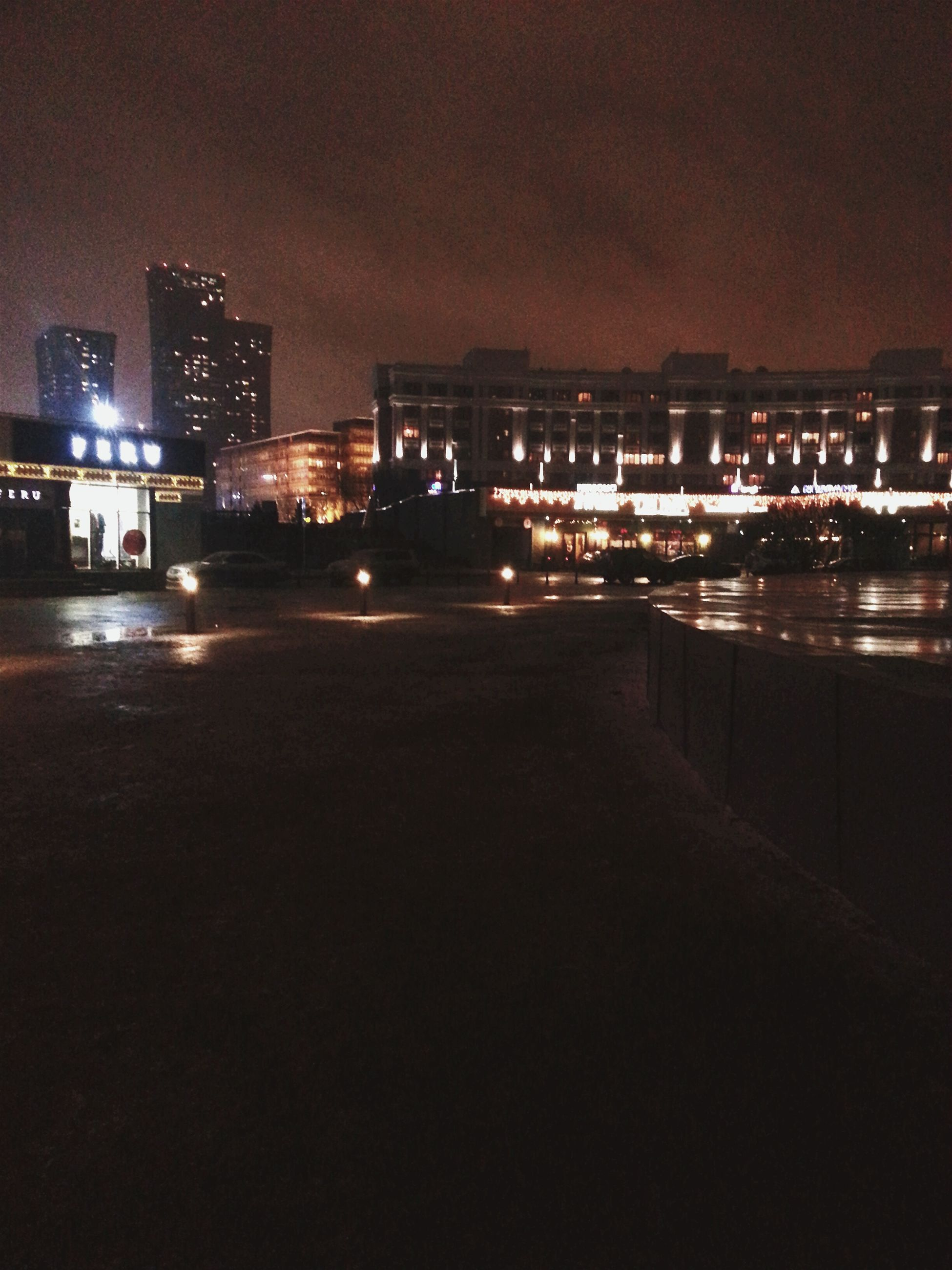 illuminated, night, building exterior, architecture, city, built structure, cityscape, dark, sky, residential building, lighting equipment, city life, street light, skyscraper, street, building, light - natural phenomenon, river, outdoors, residential structure