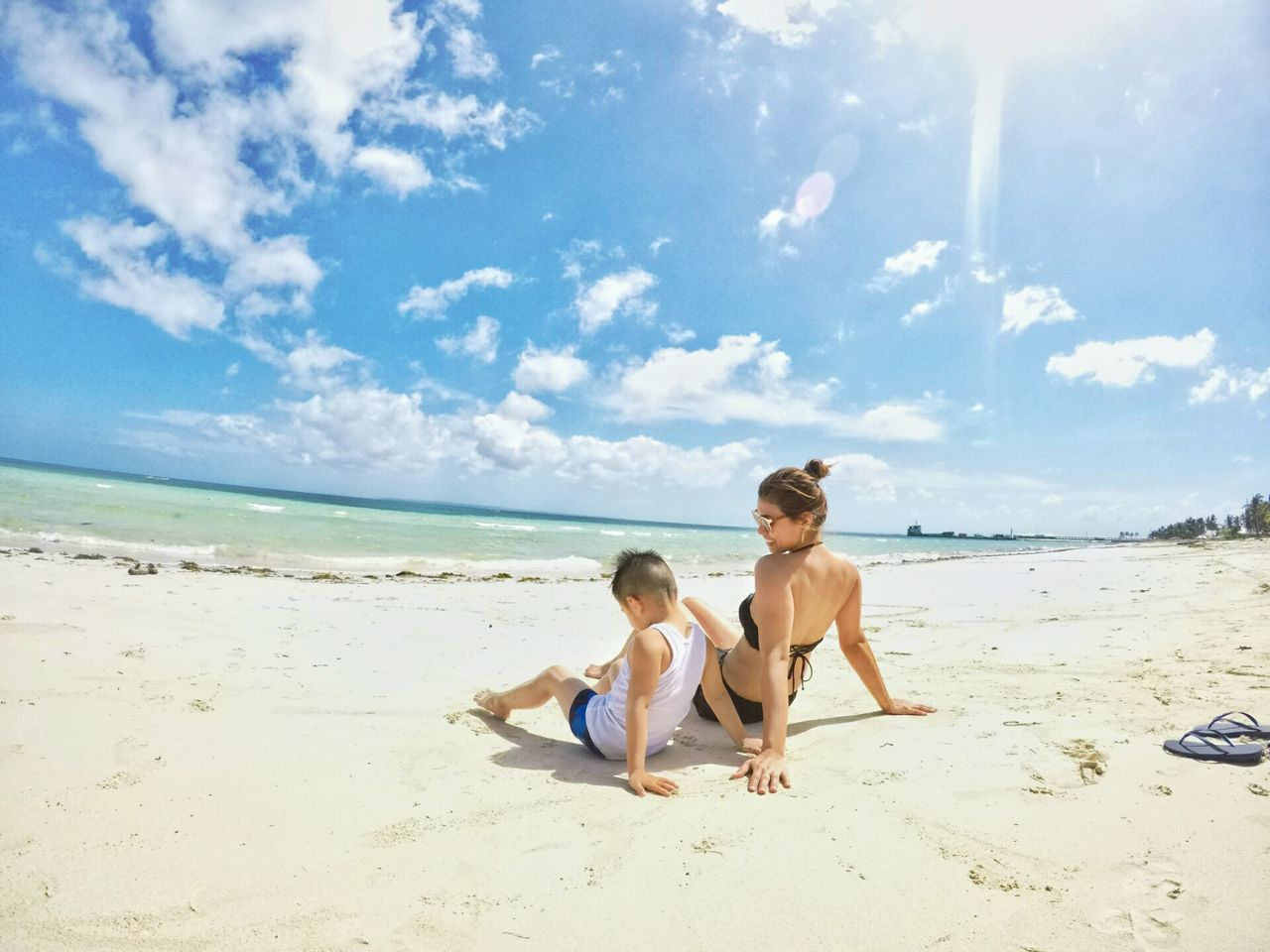 Beach Vacations Sea Child Togetherness Bonding Sand Fun Sky Blue Beachphotography MyEyemPhoto Beauty Is Everywhere  Philippine Islands Philippinesbeaches Beauty In Nature Philippines Sand & Sea Cheerful Motherandson  Two People Enjoylife Beauty Is Everywhere
