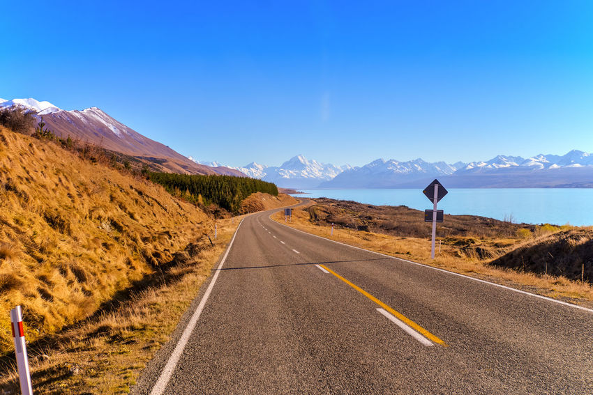 Mount cook road with lake pukaki and snow capped mountain range Day Highway Landscape Mountain Mountain Road No People Outdoors Road Scenics The Way Forward Winding Road