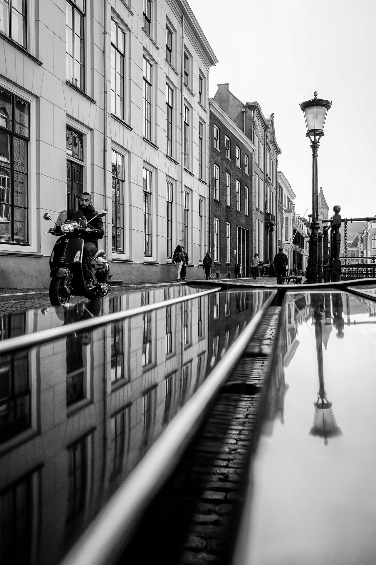 Architecture B&w Blackandwhite Building Exterior Built Structure City Day Holland Land Vehicle Men Monochrome Moped Netherlands Outdoors Real People Reflection Scooter Sky Street Light Transportation Utrecht