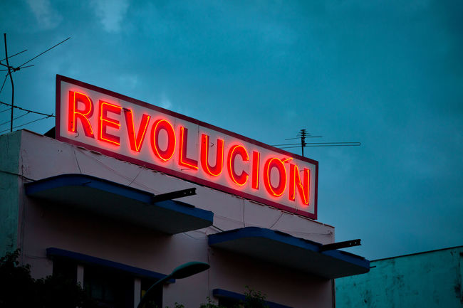 house of revolution Blue Capital Letter Clouds And Sky Cuba Dramatic Sky Evening Sky House Information Information Sign Letters In The City Neonlights Politik Red Red Letters Revolution REVOLUTION,TO BE ALL THE SAME Sign Text Western Script