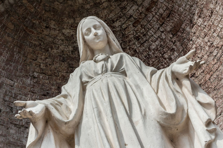 Close-up of Our Lady with open arms, bottom view. Belief Catholic Christianity Christmas Church Conception Devotion Faith Forgiveness God Holy Hug Immaculate Lady Madonna Mary Mother Our Peace Pray Queen Religion Sacred Sculpture Statue