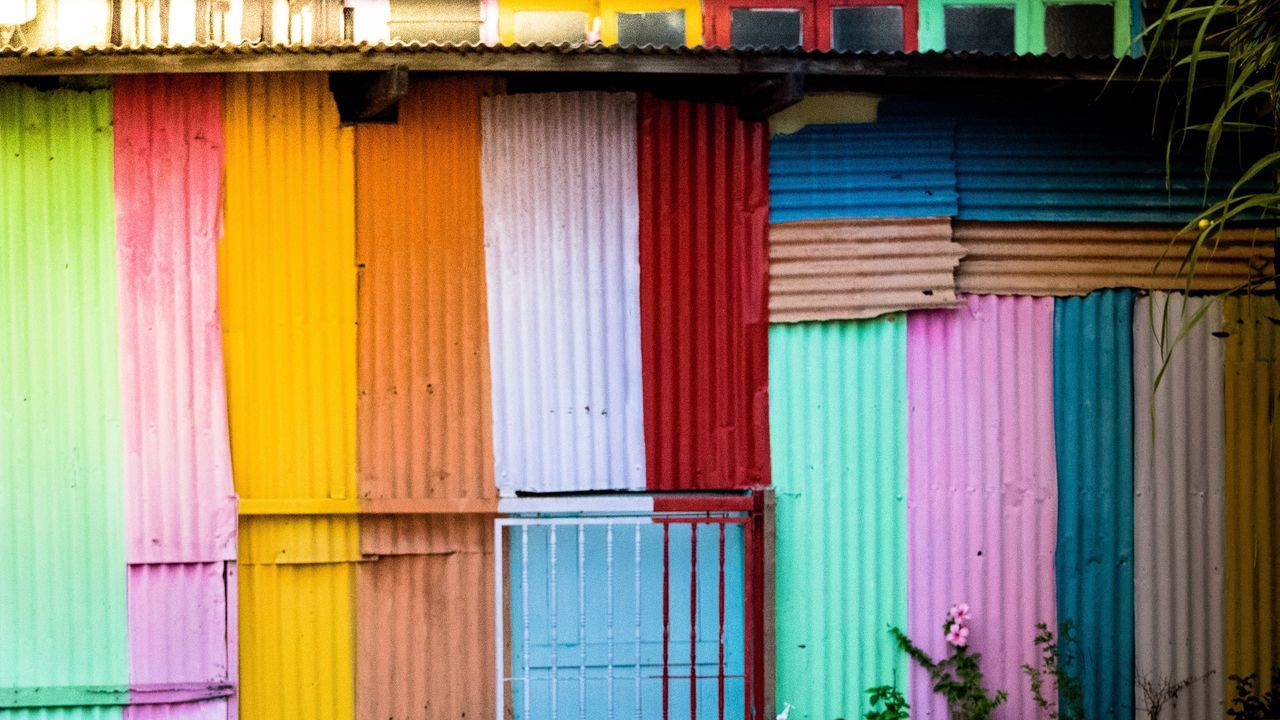 multi colored, architecture, built structure, building exterior, corrugated iron, outdoors, shutter, day, no people, wood - material