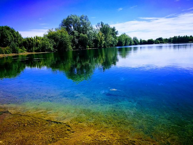 Reflection Water Lake Tree Nature Standing Water Scenics Beauty In Nature Blue Tranquility Outdoors No People Day Sky