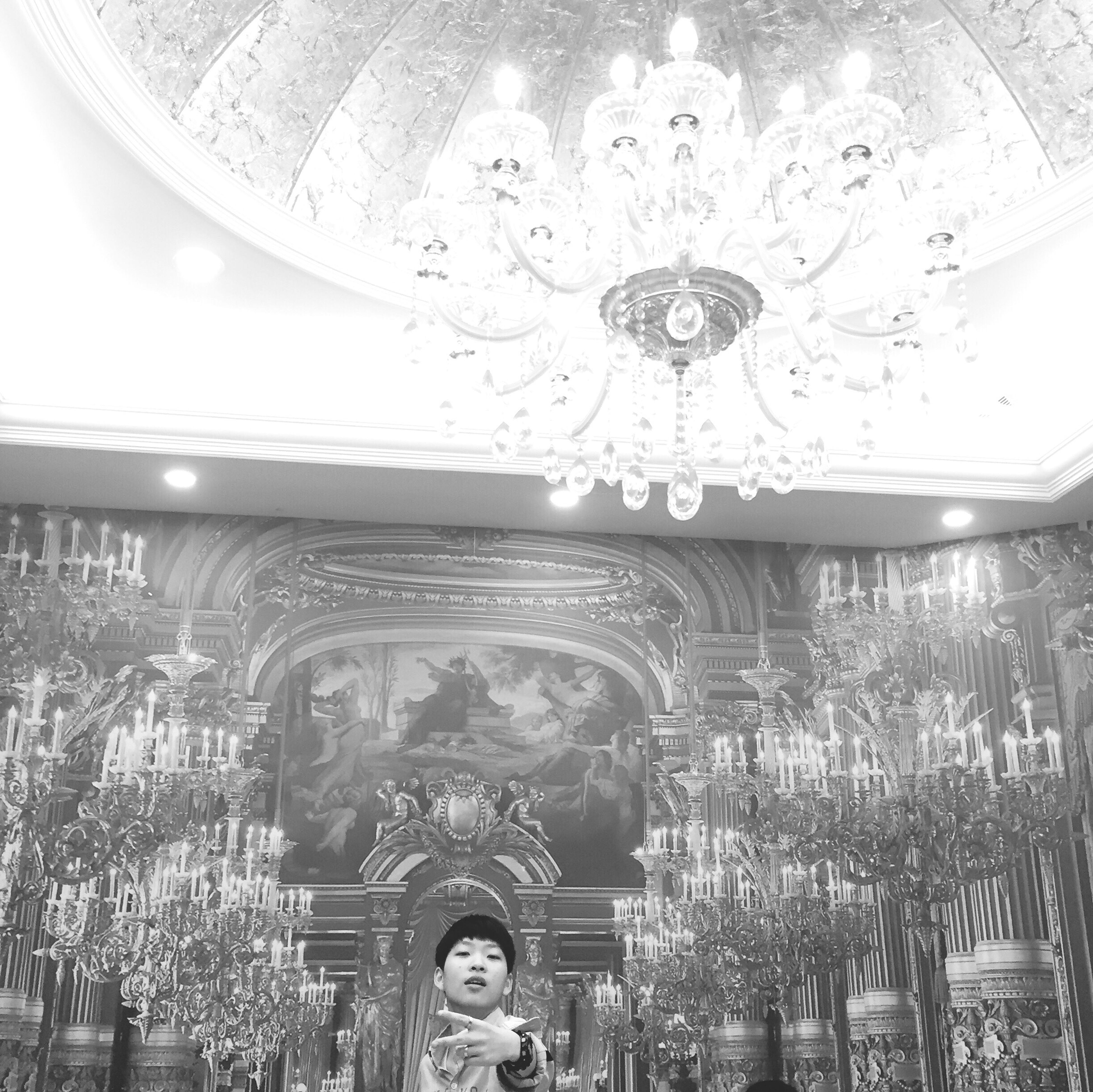 indoors, low angle view, ceiling, religion, place of worship, architecture, spirituality, decoration, lighting equipment, built structure, hanging, art and craft, ornate, chandelier, design, art, church, illuminated, creativity