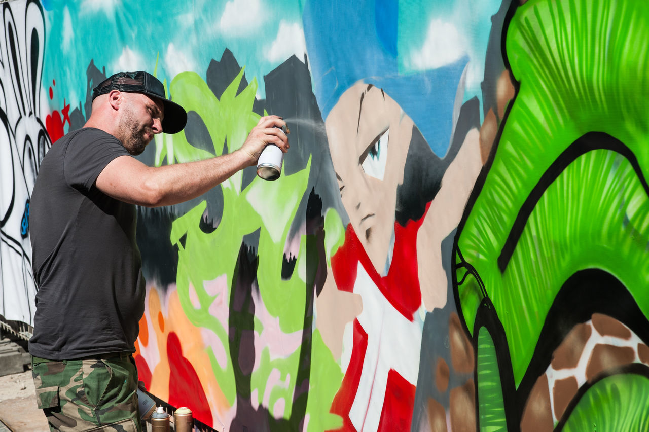 Streetart @ Amsterdam Adult Aerosol Can Airbrush Amsterdam Art And Craft Artist Day Graffiti Green Color Holland Lifestyles Men Netherlands One Person Outdoors Paint People Profession Real People Standing Young Adult