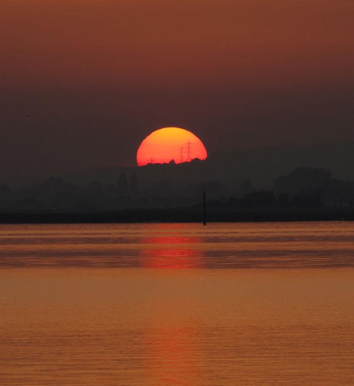 Calm Ripples Setting Sun Silhouette Dusk Evening Pilons Reflections Sea Sunset Water