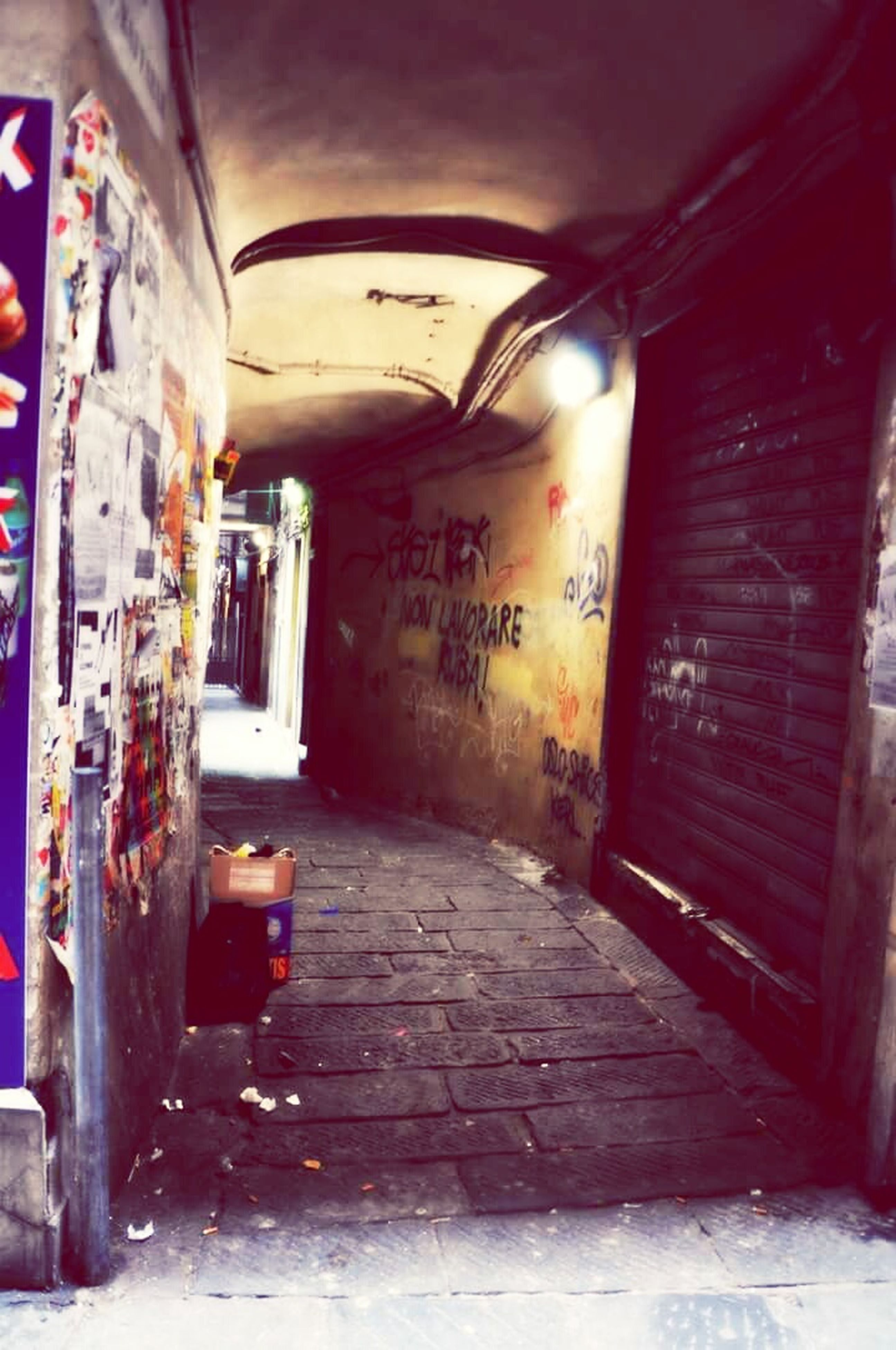 architecture, built structure, building exterior, indoors, door, wall - building feature, illuminated, the way forward, graffiti, building, house, abandoned, entrance, old, wall, alley, arch, lighting equipment, corridor, doorway