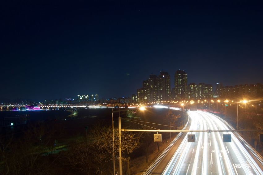 Architecture Bridge - Man Made Structure Building Exterior Built Structure Business Finance And Industry City City Life Cityscape Futuristic Highway Illuminated Light Trail Long Exposure Modern Motion Night No People Outdoors Rush Hour Sky Speed Traffic Transportation Urban Skyline