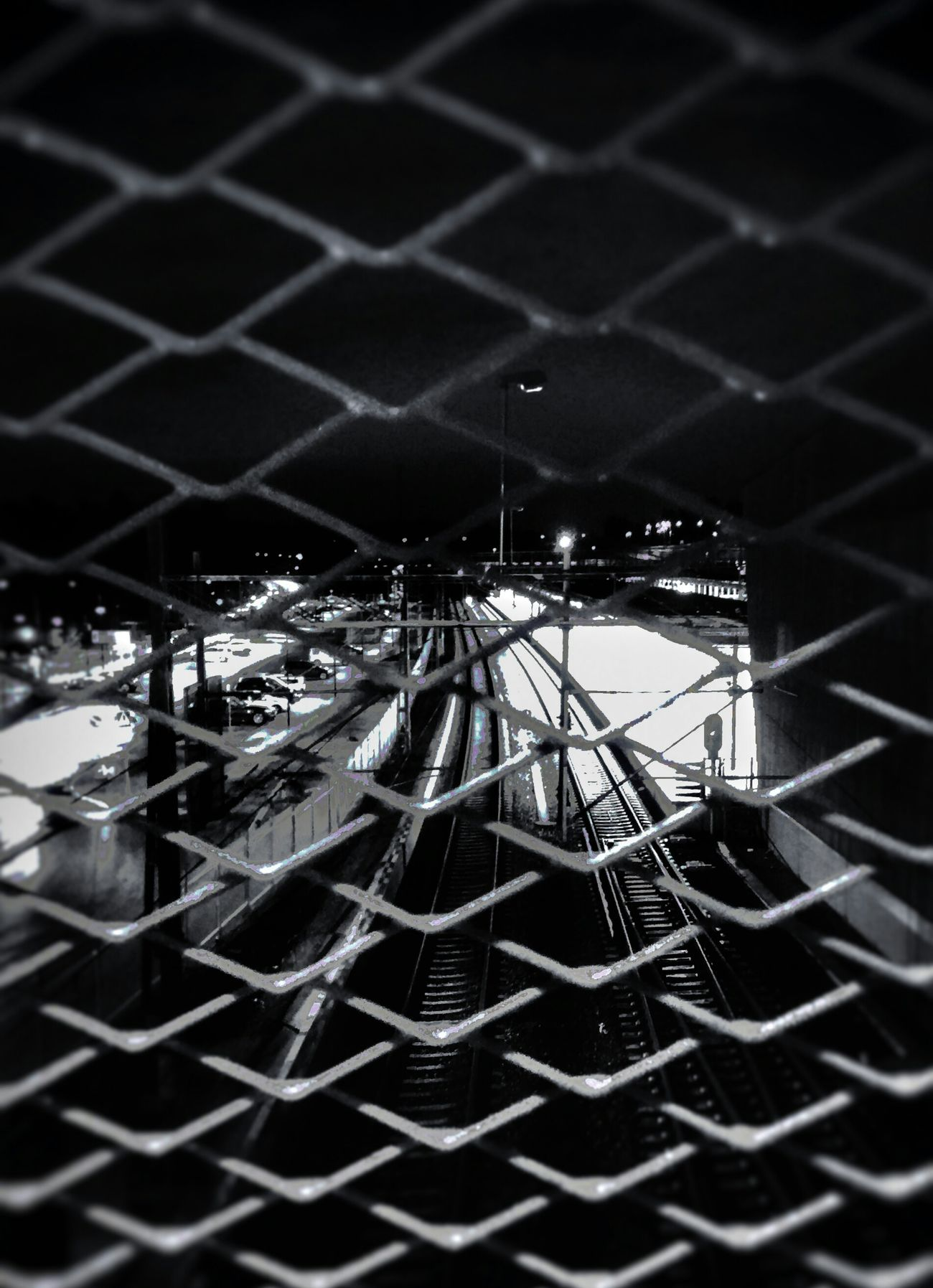Trainstation Built Structure High Angle View Train Station Fences Streetviewphotography Streetphotography Black & White Photography Architecture Lights In The Dark City Outdoors