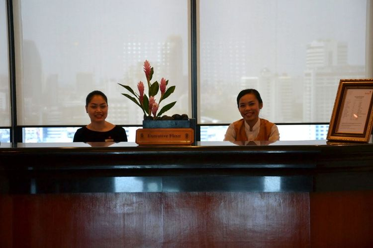 Adult Adults Only Bangkok Thailand. Cheerful Day Enjoyment Friendship Happiness Hotel Lobby Hotel Reception Hotel Receptionist Indoors  Looking At Camera People Portrait Real People Sitting Smiling Thai Smile Thailand Two People Two Women Window Young Adult Young Women