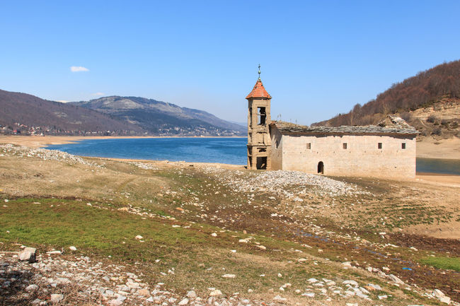 Submerged Church of Mavrovo Lake, Macedonia Architecture Balkans Beauty In Nature Blue Building Exterior Built Structure Calm Clear Sky Day East Europe Macedonia Mountain Mountain Range Nature Non-urban Scene Outdoors Scenics Sea Shore Skopje Sky Tranquil Scene Tranquility Water Waterfront