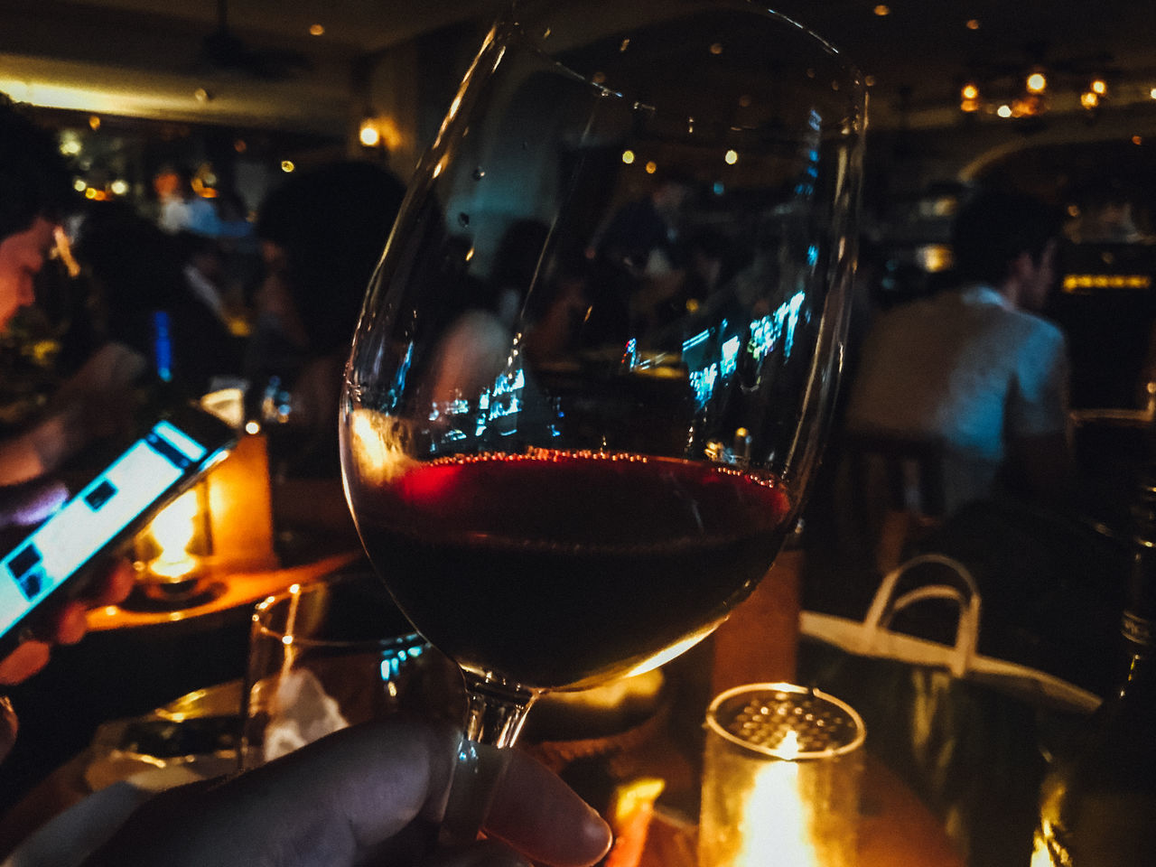 wineglass, real people, human hand, wine, night, alcohol, food and drink, drink, restaurant, human body part, two people, refreshment, illuminated, focus on foreground, men, indoors, red wine, holding, women, celebration, lifestyles, close-up, drinking glass, togetherness, freshness, food, adult, people