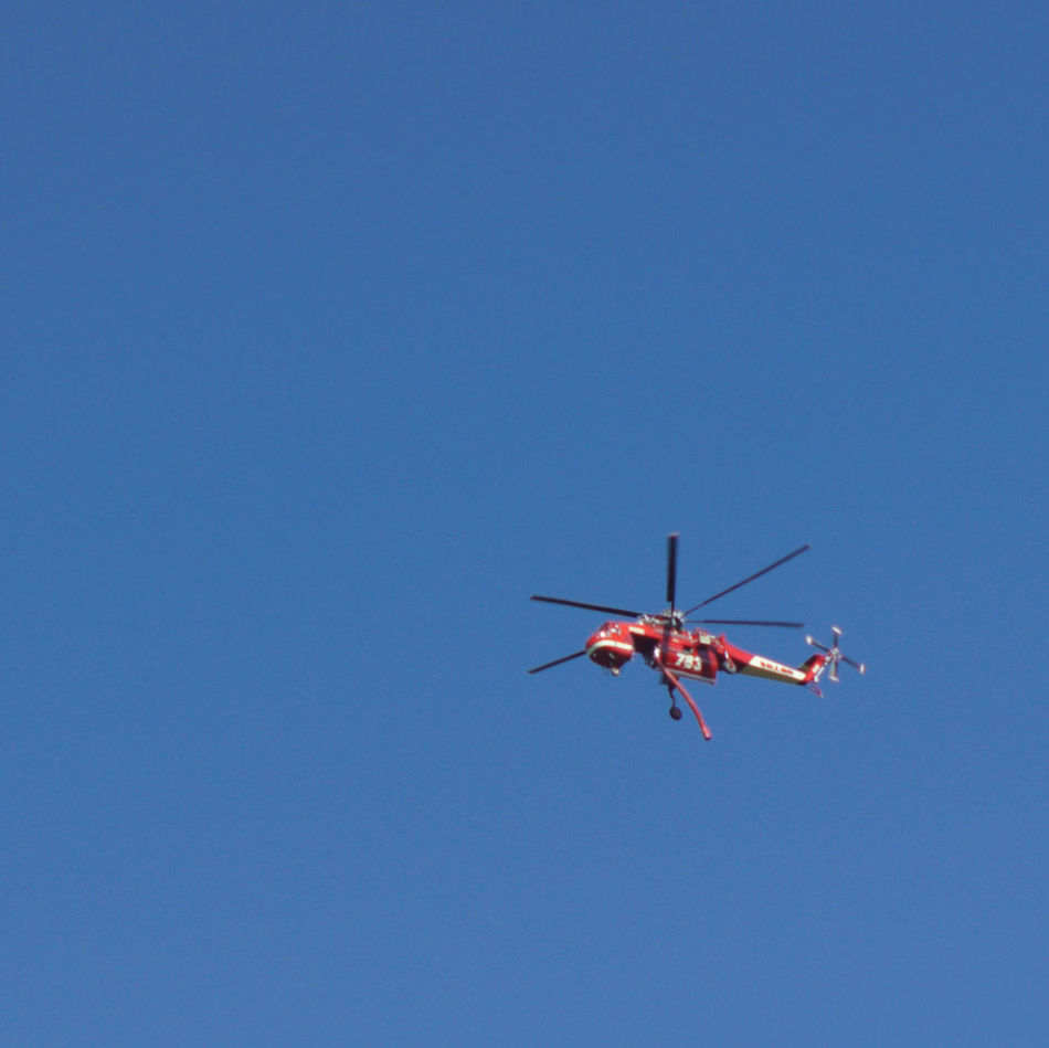 Air Vehicle Blue Clear Sky Day Firefighter Chopper Firefighter Equipment Firefighter Helicopter Flying Low Angle View Mid-air Multi Colored No People