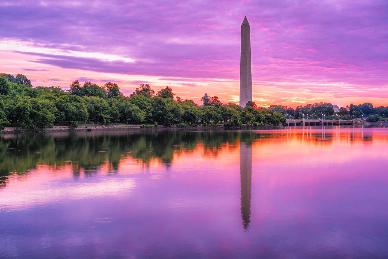 The Washington Monument at sunrise at the tidal basin in Washington D.C. Architecture Cloud - Sky Lake Nature No People Orange Color Outdoors Reflection Scenics Sky Sunrise Tourism Tranquil Scene Washing Water
