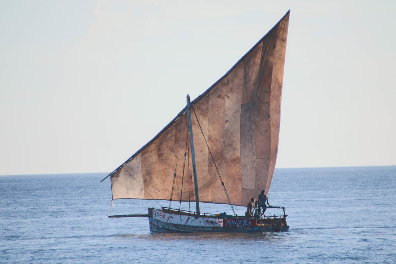 Traditional Sail Fishing Boat in Zanzibar Clear Sky Day Dhow Fishing Boat Horizon Over Water Mode Of Transport Nature Nautical Vessel No People Outdoors Sailing Sea Sky Transportation Water