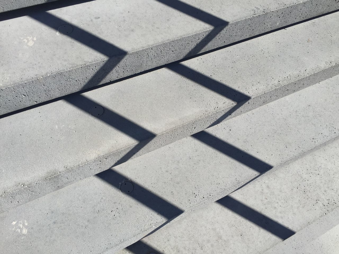 Shadow Sunlight High Angle View Flooring Focus On Shadow Repetition Outdoors Geometric Shape No People Stone Material Concrete Precast Concrete