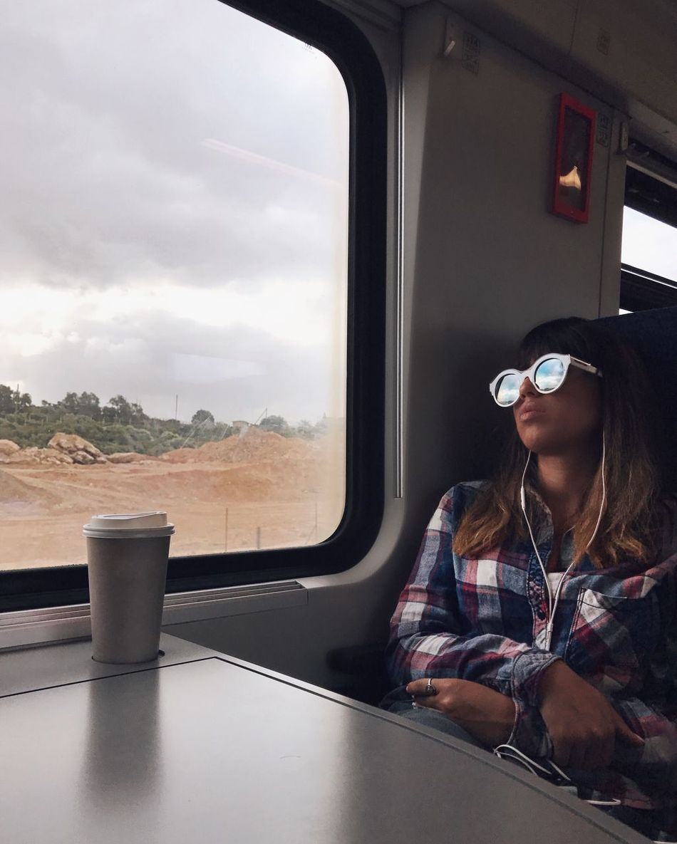 Vehicle Interior Window Sunglasses One Person Mode Of Transport Headphones Real People Transportation Sitting Looking Through Window Day Sky Indoors  Music Young Adult Eyeglasses  Young Women Technology People IPhone7Plus Shotoniphone7plus מייאייפון7 Mydtrainmoments Mytrainmoments TCPM